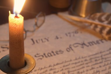 Selective focus view of Declaration of Independence with burning