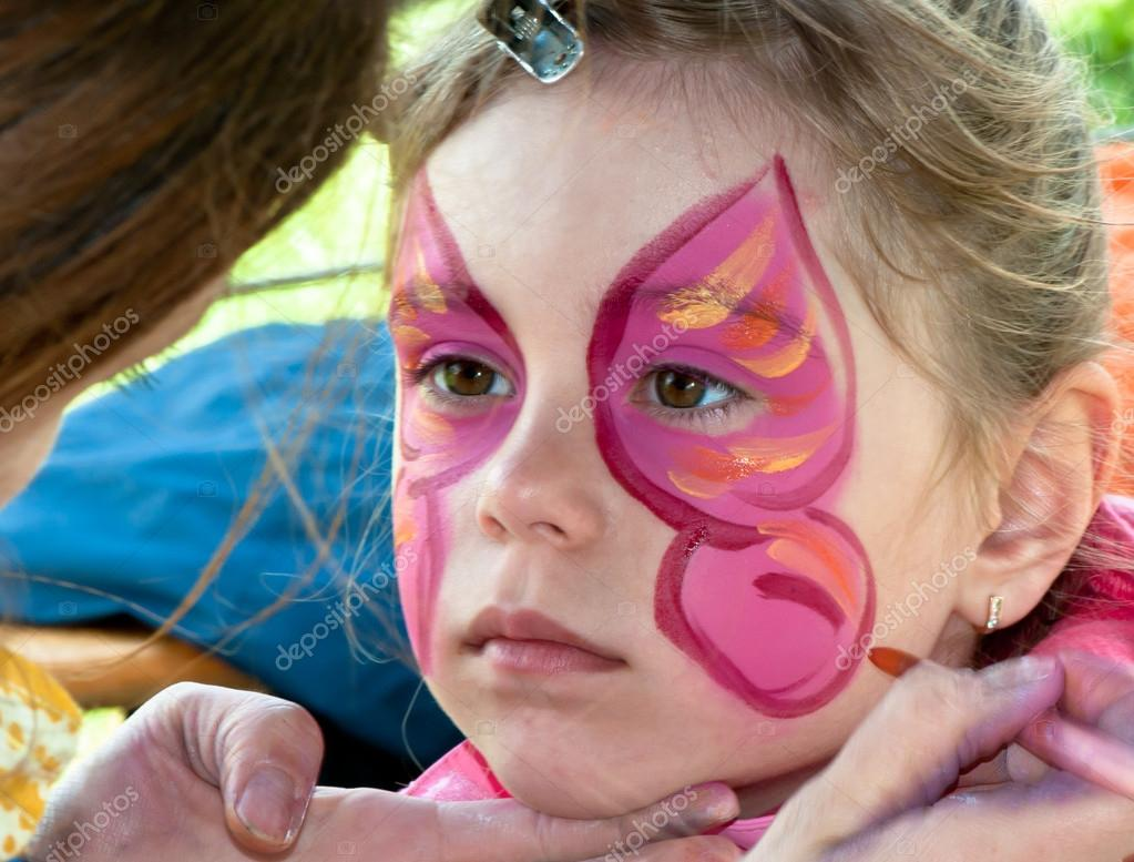 Child Preschooler With Face Painting Make Up Stock Photo