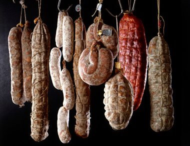 Row of hanging salamis
