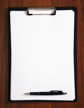 Blank clipboard with a pen on table stock vector