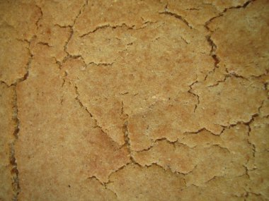 Cracked surface - crust of corn bread background