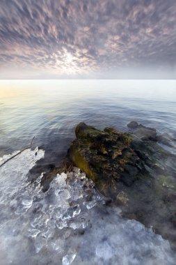 Myst on the sunset ocean
