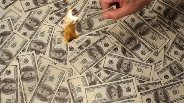 Businessman holding burning money cut out
