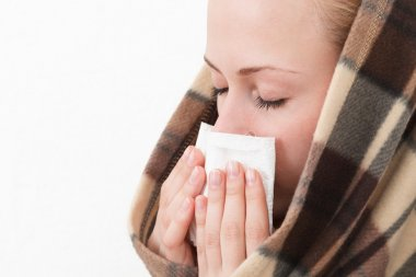 A woman with a symptoms cold