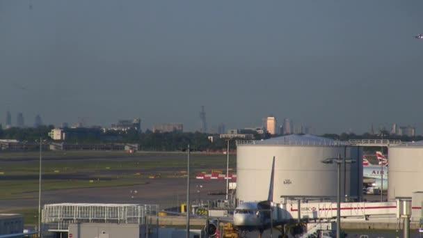 British Airway Airplanes land during rush hour in Heathrow, London, England