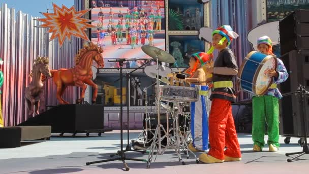 Kids with costumes and drums sing during the Murga competition of the carnival