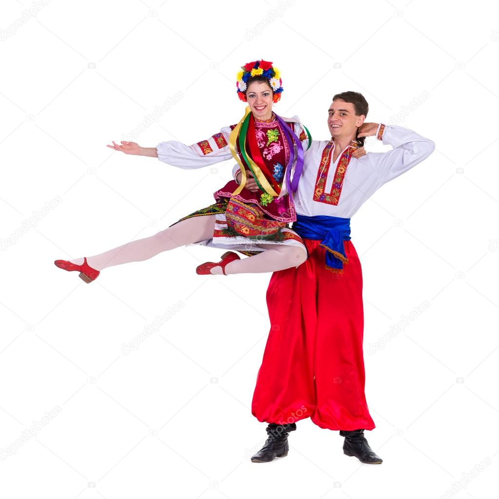 Beautiful dancing couple in ukrainian polish national traditional costume clothes happy smile, full length portrait isolated