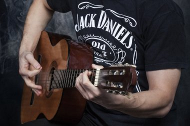 Human hands on a guitar