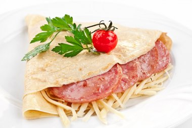 Pancakes with ham, cheese and vegetables