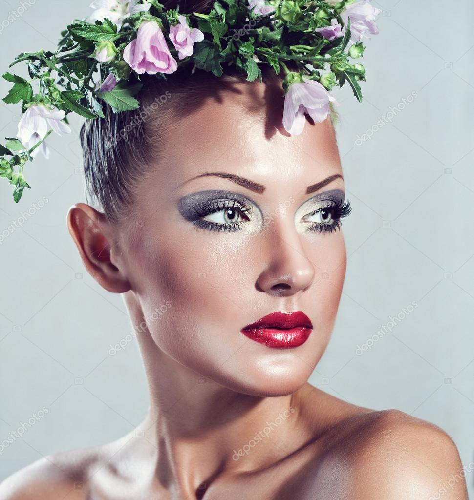 Fashion model beautiful woman with flowers on her head glamour fashion model beautiful woman with flowers on her head glamour makeup stock photo dhlflorist Gallery