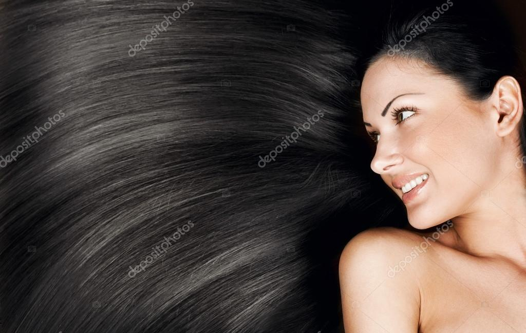 Close-up portrait of a beautiful young woman with elegant long shiny hair, conceptual hairstyle