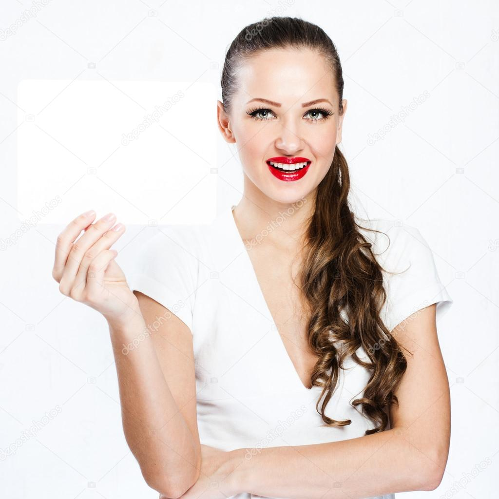 young smiling woman holding blank business card stock photo