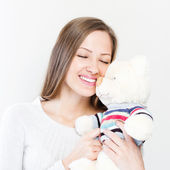 Brunette embraces teddy bear