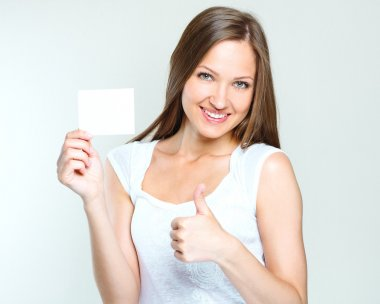 Happy woman holding blank poster