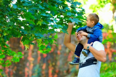 father and son having fun among colorful nature