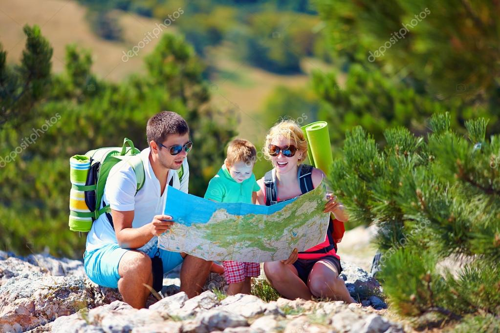 family in mountains discussing the route