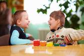 Fotografie relation between kids with disabilities in preschool