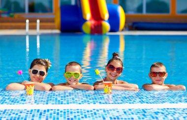 group of happy teenage kids in the pool