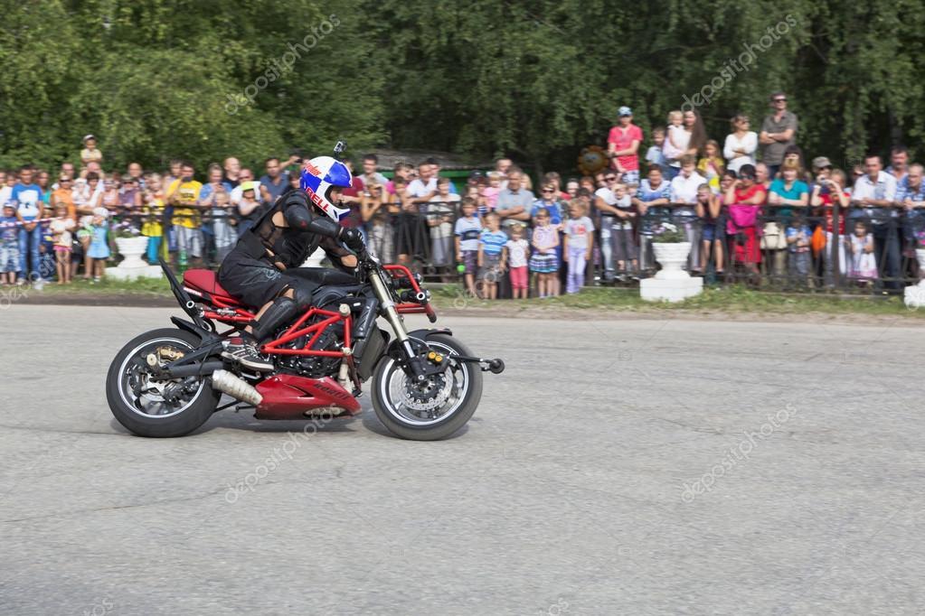 Motorcycle show in village Verkhovazhye, Vologda Region, Russia. Alexei Kalinin motorcycle accelerates