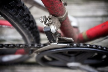 Close-up Of Chain Derailleur Assembly of a Dirty Mountain Bike