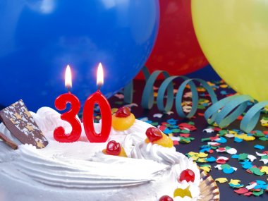 Birthday cake with red candles showing Nr. 30