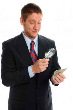 Bussiness Man Looking At Money Magnifying Glass