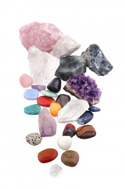 Group of various kinds of crystals on white background