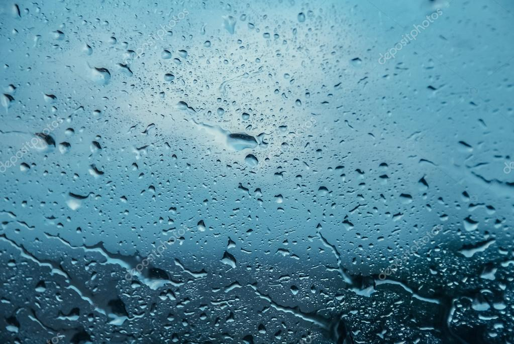 Moving water drops on a window glass