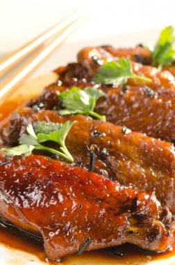 Chicken wings in chinese sauce with puer tea and herbs