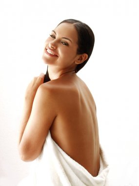 Beautiful young latin woman on white background.