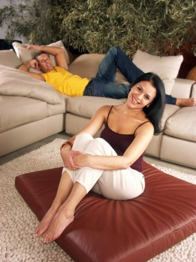 Young hispanic couple enjoying in a living room. Young couple enjoying in a house.