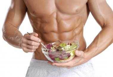 Shaped and healthy body man holding a fresh salad bowl,shaped abdominal