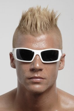 Punk hairstyle sunglasses man portrait.