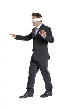 Blindfold businessman on white background