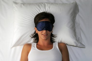 Beautiful sleeping young woman in sleep eye mask