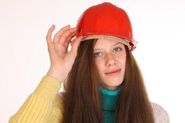 Charming girl in the construction helmet.