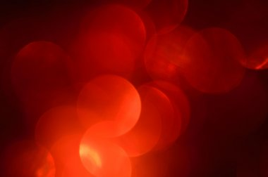 Blurred, bokeh red lights background. Abstract sparkles