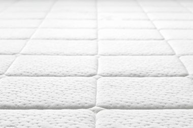 Close-up of white mattress texture.
