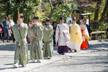 KAMAKURA, JAPAN - MARCH 22 2014: Traditional wedding in Tsurugaoka Hachimangu Shrine. One the most important Shinto shrine in Kamakura and an Important Cultural Property of Japan.