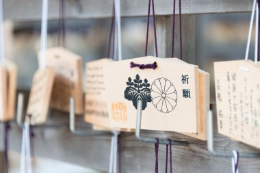 TOKYO, JAPAN - APRIL 10 2014: Wooden prayer tablets at a Meiji Shrine(Meiji Jingu). Pray for happiness ,good life ,healthy ,peace ,luck by write praying word in wooden tablet.