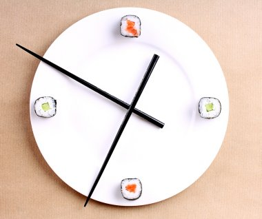 Sushi time in the form of a wall clock