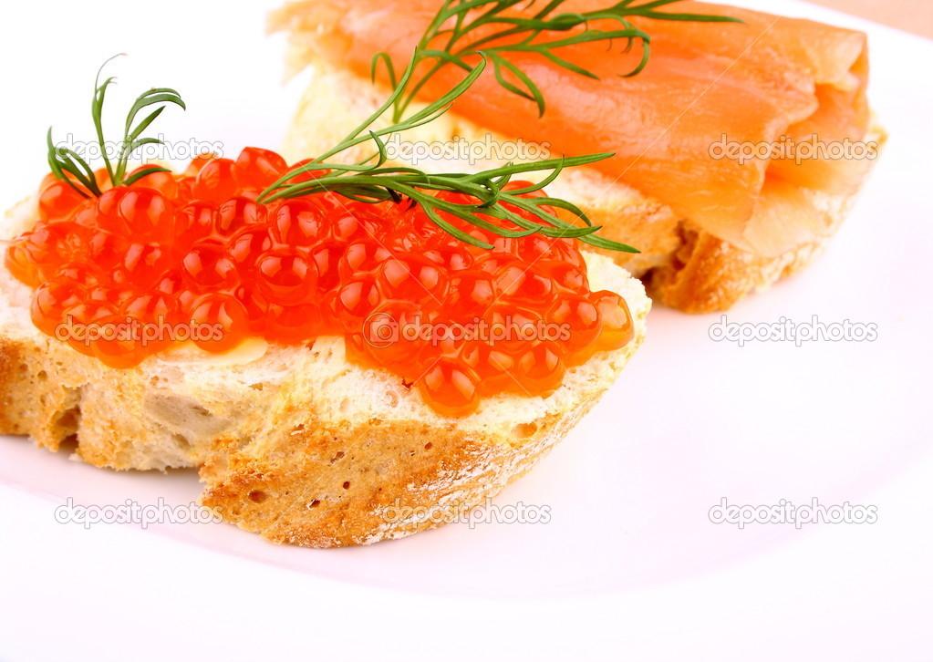 Caviar bread topped with keta salmon eggs stock photo caviar bread topped with keta salmon eggs closeup photo by diamant24 ccuart Choice Image