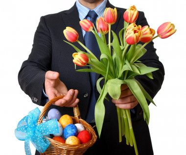 Man in suit and tie gives tulips and Easter basket
