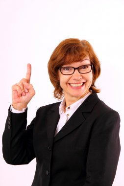 Happy, mature redhead business woman with eyeglasses