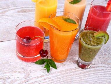 Fruity drinks juice from cherry, kiwi, tangerine