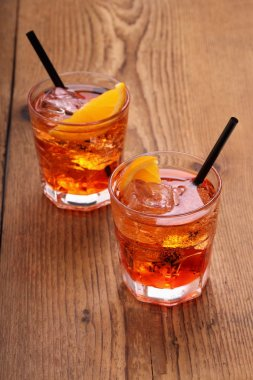Spritz aperitif, two orange cocktail with ice cubes
