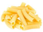 Uncooked pasta tubes rigatoni isolated on white background