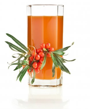 Sea buckthorn berries juice on the glass