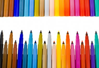 Multicolored felt pens border frame on white