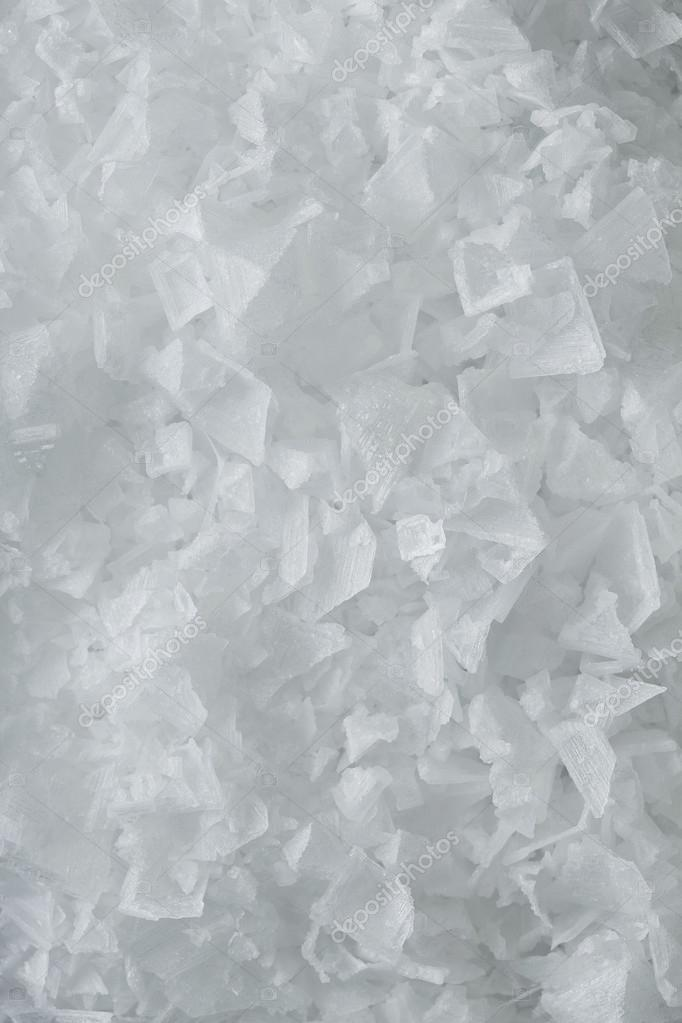 Sea salt crystals flakes, textured background